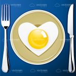 Breakfast Set with a Fork, a Knife, a Plate and a Heart Shaped Egg