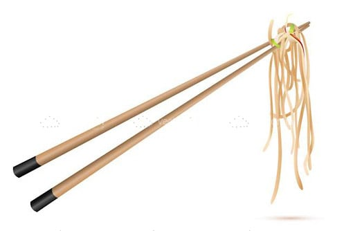 Chopsticks Holding Noodles on a White Background